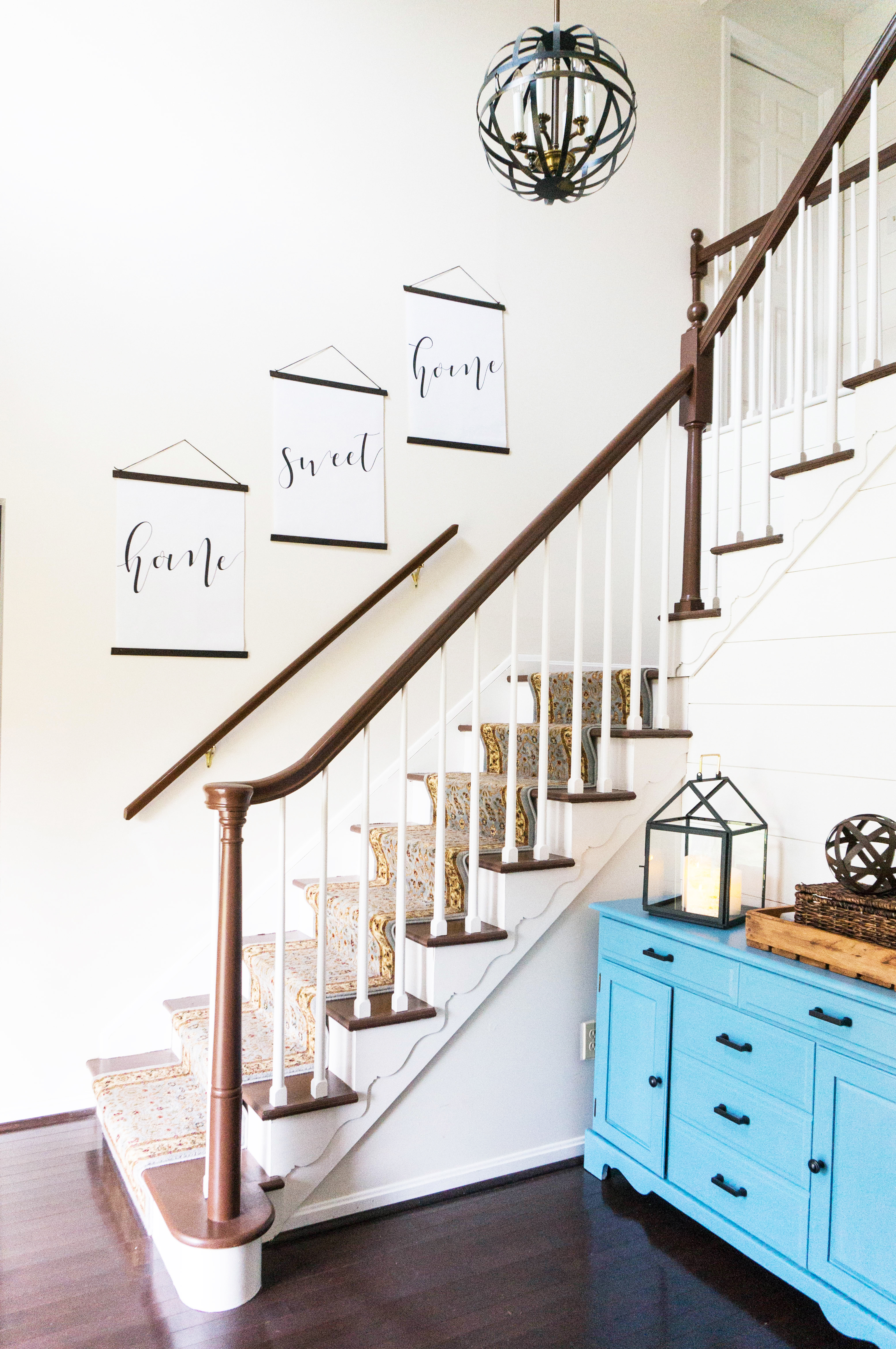Inexpensive entry remodel reveal. Find out how our farmhouse foyer turned out. Our fixer upper foyer needed a major redo. See how we rennovated our foyer on a budget. #farmhousedecor #farmhouse #fixerupper #foyer #entryway