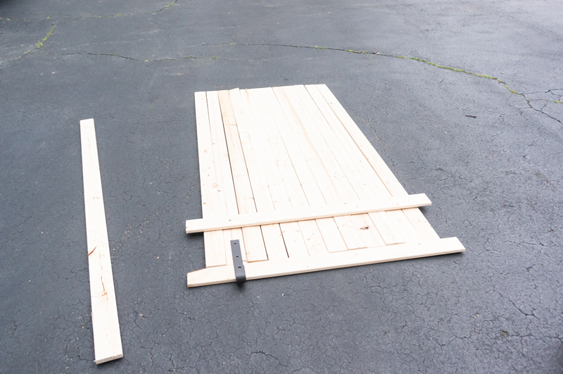DIY Barn Door - Learn how to Build a DIY Door for less than $100. #barndoor #diy #diyproject #farmhousestyle