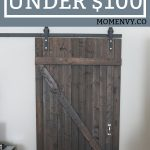 DIY Barn Door - Learn how to Build a DIY Door for less than $100. #barndoor #diy #diyproject #farmhousestyle