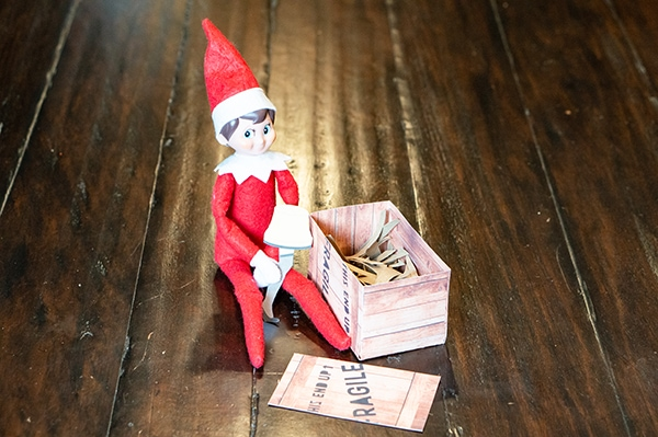 Christmas Story Elf on a Shelf. Download this free Elf on a Shelf printable Christmas Story set featuring the famous Fragile Leg Lamp scene. #elfonashelf #christmasstory #christmasfreebies