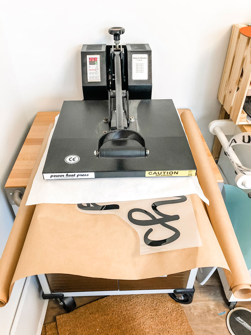 #shop This image shows a heat press pressing kraft paper with black words.