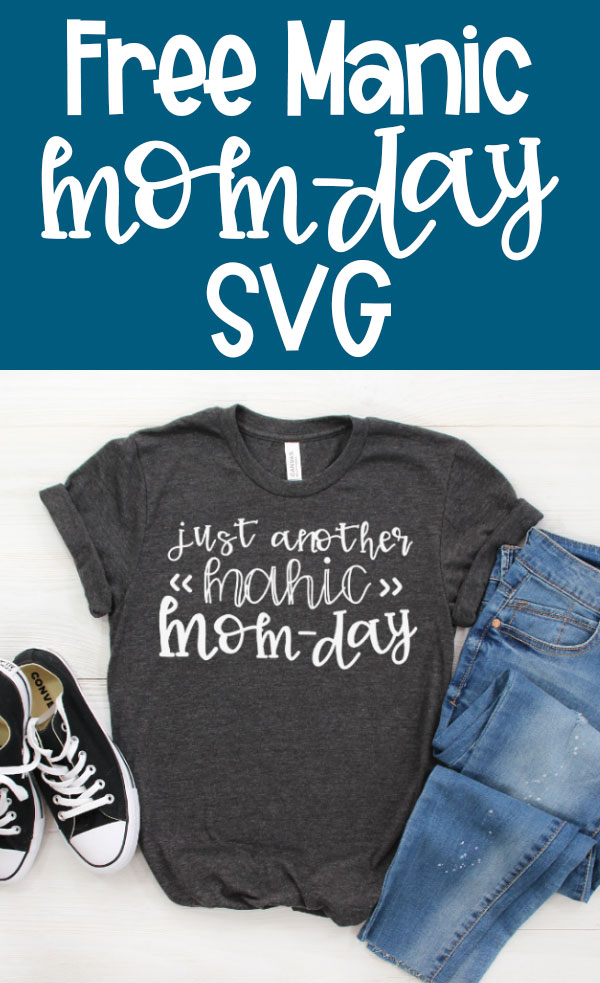 Free Manic Mom Day SVG is on the top in white text on a medium blue background. To the bottom is an image of a gray t-shirt with the words, Just another Manic Mom-Day. Next to a pair of blue jeans and black converse sneakers.